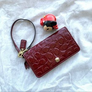 Coach wristlet with cards compartment and zip coin pocket in deep red plum color